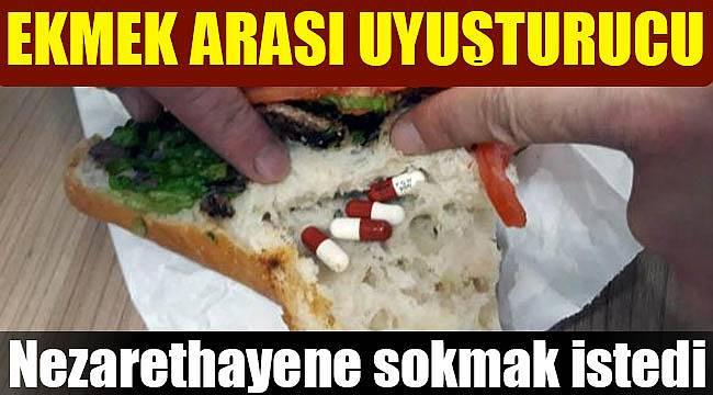 Nezarethaneye ekmek arasında uyuşturucu hap sokmaya çalıştı