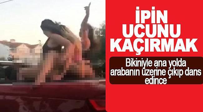 Bikiniyle arabanın üzerine çıkıp dans edince gözaltına alındılar