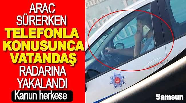 Polis araçta cep telefonuyla konuşurken görüntülendi, bir anda fenomen soldu